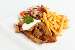 Doner. Turkish doner with french fries and salad stock image