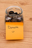 donera hjälppengar var god Arkivfoton