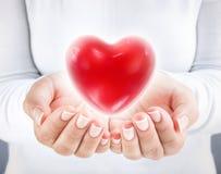 Donera hjärta fotografering för bildbyråer