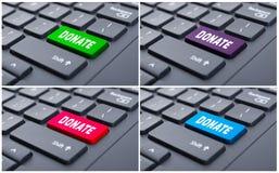 Donera knappen på datortangentbordet arkivfoton