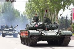 Donetsk, Donetsk People Republic, Ukraine – May 9, 2019: Armored soviet tanks T-72 driving through the main street of the royalty free stock photo