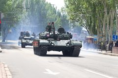 Donetsk, Donetsk People Republic, Ukraine – May 9, 2019: Armored soviet tanks T-72 driving through the main street of the stock image