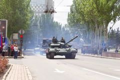 Donetsk, Donetsk People`s Republic, Ukraine – May 9, 2019: Column of armored military vehicles with soldiers on it driving royalty free stock image
