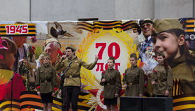 Donetsk - May, 9, 2015: Artists sing wartime songs at a concert Royalty Free Stock Image