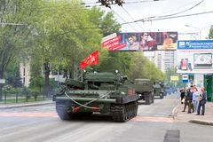 Donetsk, Donetsk People Republic, Ukraine – May 9, 2019: Column of military technics driving through the main street of the stock photography