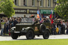 Donetsk People Republic, Ukraine. 2016, May 9. - Russian military veterans of World War II riding in the old car on Victory Parade. Donetsk People Republic stock photos