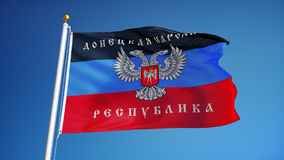 Donetsk People's Republic flag in slow motion seamlessly looped with alp. Donetsk People's Republic flag waving in slow motion against blue sky, seamlessly stock footage