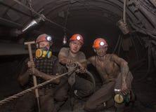 Donetsk Ukraina - mars, 14, 2014: Gruvarbetarna som arbetar undergrou Arkivfoto