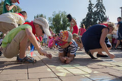 Donetsk, Ukraine - August 27, 2017 - Children paint with chalk on the asphal. T at the celebration of the City Day Royalty Free Stock Photo