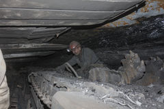 Donetsk, Ukraine - August, 16, 2013: Miner near the coal mining. Shearer. Mine is named Chelyuskintsev Stock Photography