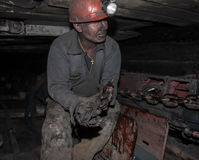 Donetsk, Ukraine - August, 16, 2013: Miner repairs coal mining c Stock Photo