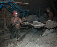 Donetsk, Ukraine - August, 16, 2013: Miners perform heavy manual Stock Photography