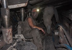 Donetsk, Ukraine - August, 16, 2013: Miners at work in cramped. Conditions underground excavation. Mine name Chelyuskintsev royalty free stock images