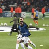 Players Juventus Asamoah in the foreground and Lichtsteiner N. DONETSK, UKRAINE - DECEMBER 5, 2012: Players Juventus Asamoah in the foreground and Lichtsteiner stock photos