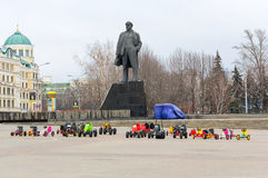 Donetsk, Ukraine - February, 11, 2015: Childrens rides on the deserted central square against the backdrop of the monument to Len Royalty Free Stock Photos