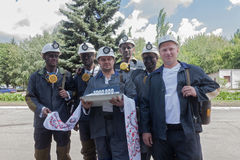 Donetsk, Ukraine - 26 July, 2013: Miners with coal symbolic ingo Royalty Free Stock Image