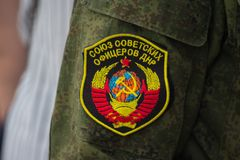 Donetsk, Ukraine - June 12, 2019: Chevron of the fighter of army of the DPR with the Soviet coat of arms. And an inscription `The union of the Soviet officers royalty free stock images