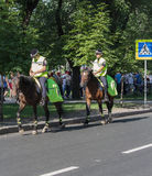 Donetsk, Ukraine - June 11, 2012: Police on horseback patrolling the streets Royalty Free Stock Images