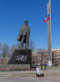 Donetsk, Ukraine - March , 25, 2015: The central area of the rebel Donetsk. The statue of Lenin, pictures of dead children during the confrontation Donbass Stock Photography