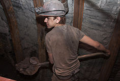 Donetsk, Ukraine - March 14, 2014: Miner working a shovel Royalty Free Stock Image