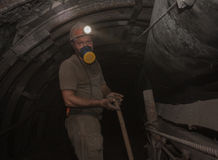 Donetsk, Ukraine - March, 14, 2014: The miner working undergroun Royalty Free Stock Photos