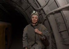 Donetsk, Ukraine - March, 14, 2014: Woman surveyor in the underground mine. Mine is named Abakumov royalty free stock photography
