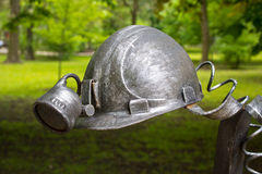 Donetsk, Ukraine - May 09, 2017: Miner`s helmet forged figures forged from metal. In the park Stock Photo