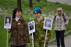 Donetsk, Ukraine - May 09, 2017: Women participating in procession immortal regiment with portraits Stock Photo