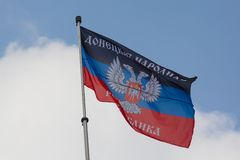 Donetskk, Ukraine - August 27, 2017: Flag of the self-proclaimed Donets People`s Republic on the central square of the city. Donetsk, Ukraine - August 27, 2017 stock photo
