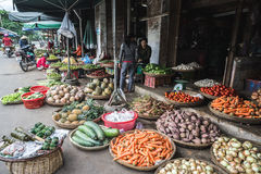 Ba Market in Hue, Vietnam. Vietnamese locals selling fruits and vegetables outdoors at Ba Market in Hue, Vietnam royalty free stock image