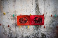 Dong Ho paintings on old aged wall. Dong Ho folk woodcut ancient painting, an aesthetic symbol in Vietnam culture.  Stock Photo