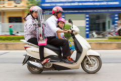 DONG HOI, VIETNAM, 7 AUGUST 2012 - Complete Vietnamese family wi. Th a bicycle on a scooter. With an estimated number of 20 million the scooter is Vietnams most Royalty Free Stock Photography