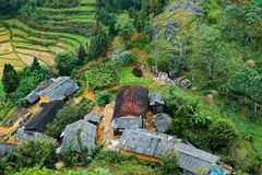 VAN, HA GIANG, VIETNAM, October 27th, 2018:spring on, the simple houses, blooming peach flowers trees, rock plateau. Where Ha Giang, Vietnam northernmost royalty free stock image