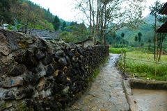 VAN, HA GIANG, VIETNAM, October 27th, 2018:spring on, the simple houses, blooming peach flowers trees, rock plateau. Where Ha Giang, Vietnam northernmost stock photos