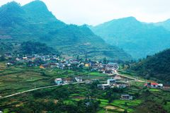 VAN, HA GIANG, VIETNAM, October 27th, 2018:spring on, the simple houses, blooming peach flowers trees, rock plateau. Where Ha Giang, Vietnam northernmost royalty free stock photo