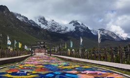 Dongba cultural park under yulong snow mountain stock photography