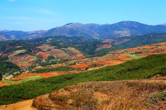 The Dazzling Dongchuan Red Soil Scenic Area. Dongchuan Red Soil Scenic Area is located in a warm and humid environment. Iron in the soil is slowly deposited by stock images