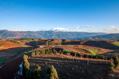 Dongchuan, Yunnan Province after snow Colorful slope Red Land Stock Photos
