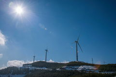Dongchuan, Yunnan Red Land playing Macan after the snow wind turbine group stock photo