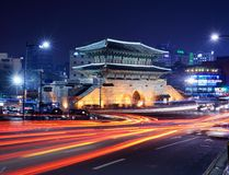 Dongdaemun Gate. Traffic passes Dongdaemun Gate February 13, 2013 in Seoul, KR. The structure dates from 1398 and is one of the The Eight Gates of Seoul Stock Photography