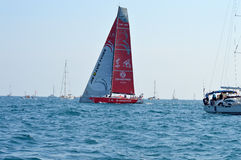 Dongfeng Race Team From China Pass A Spectator Boat At The Start Of The Volvo Ocean Race Royalty Free Stock Photography
