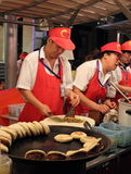 Donghuamen night food market in Beijing: Bread. The photo shows the sellers at the famous Donghuamen night food market in Beijing Royalty Free Stock Photos