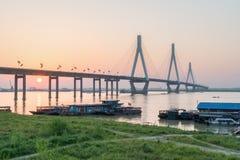 Dongting lake bridge with setting sun Stock Images