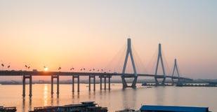 Dongting lake bridge with setting sun Royalty Free Stock Photo