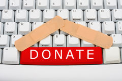 Doni i soldi in linea Fotografie Stock Libere da Diritti
