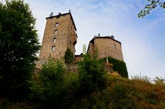 Medieval Reinhardstein castle Belgium. The donjon tower of the medievel Reinhardstein fortification and castle near Robertville and Eupen in the German Speaking royalty free stock photos