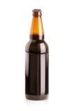 Donker bier in een fles Royalty-vrije Stock Foto's