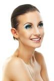 Donker-haired glimlachende vrouw in grijze kleding Royalty-vrije Stock Foto