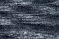 Donkerblauwe achtergrond van dichte geweven in zakken doende stof, close-up Structuur van de textielmacro Stock Afbeeldingen