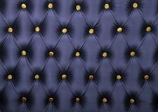 Donkerblauwe capitone met gouden knopentextuur Royalty-vrije Stock Afbeeldingen